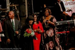 Sherry Mackey and Tracy Bethea presents roses to CeCe Winans.